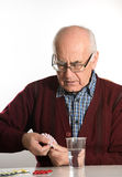 Senior man taking pills Stock Photography