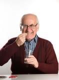 Senior man taking pills Stock Photos