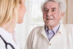 Senior man talking with doctor Stock Photo
