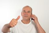 Senior man talking on a mobile cell phone Royalty Free Stock Photo