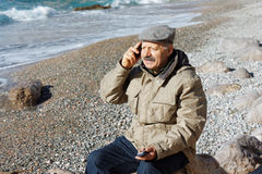 Senior man talking by mobile phone Stock Photos