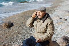 Senior man talking by mobile phone Stock Photos