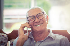 Senior man talking on mobile phone Stock Image