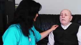 Senior man talking with nurse stock video footage