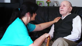 Senior man talking with nurse stock footage