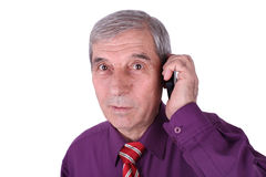 Senior man talking on phone Stock Photo