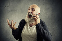 Senior man talking on the phone and laughing Stock Photo