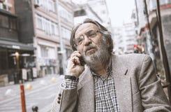 Senior man talking phone in outdoors royalty free stock image