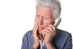 Senior man talking on the phone Stock Images