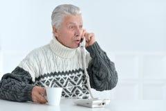 Senior man talking on phone. Portrait of senior man talking on phone, sitting Royalty Free Stock Photos