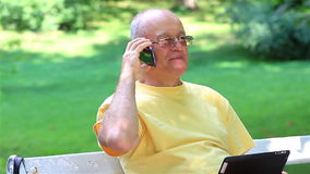 Senior man talking on smart phone stock footage
