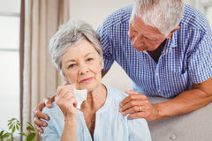 Senior man talking to upset senior woman Royalty Free Stock Images