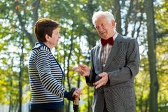 Senior man talking with woman stock images