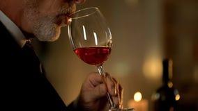 Senior man tasting exquisite wine in restaurant, celebration restaurant, leisure royalty free stock photos