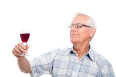 Senior man tasting wine Stock Photo