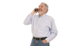 Senior Man on Telephone. Senior man on the telephone smiling set against a white background Stock Photography