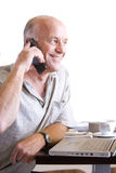Senior man on telephone with cup of coffee, cut out Stock Photo