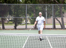 Senior Man on Tennis Court Stock Photo