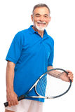 Senior man with a tennis racket Stock Image
