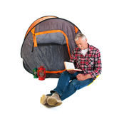 Senior man by tent Stock Images