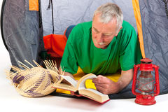 Senior man by tent Royalty Free Stock Photos