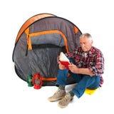 Senior man by tent Royalty Free Stock Photo