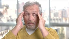 Senior man with terrible head pain. Elderly man suffering from headache. Causes of migraine stock footage