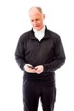 Senior man text messaging on a mobile phone Royalty Free Stock Image