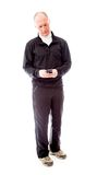 Senior man text messaging on a mobile phone Royalty Free Stock Photos