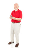 Senior Man Texting. On his cellphone.  Full body isolated on white Royalty Free Stock Photography