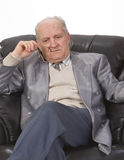 Senior man thinking. Portrait of a senior man thinking deeply in his office armchair Royalty Free Stock Photography