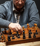 Senior man thinking about his next move in a game of chess Royalty Free Stock Photography