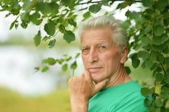 Senior man thinking outddor Stock Photos