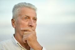 Senior man thinking Royalty Free Stock Photo