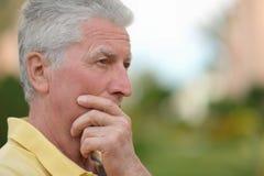 Senior man thinking about something Royalty Free Stock Photography