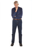 Senior man in thoughtful pose Stock Image
