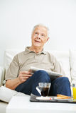 Senior man thoughtfully looking up Stock Photo