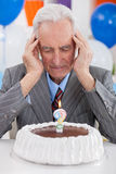 Senior man thoughts about his age Royalty Free Stock Image