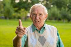 Senior man threatens with finger. Royalty Free Stock Images