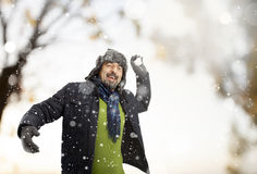 A senior man throwing a snowball Royalty Free Stock Photography