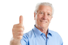 Senior man thumb up stock photography