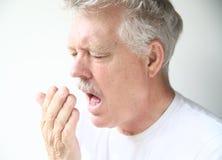Senior man about to sneeze Royalty Free Stock Image