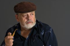 Senior man with tobacco-pipe Royalty Free Stock Photography