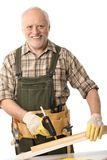 Senior man with tools. Happy senior man working with tools, cutout Royalty Free Stock Images