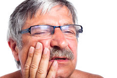 Senior man with toothache royalty free stock photo