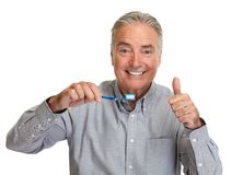 Senior man with toothbrush. stock photography