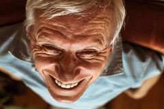 Senior man toothy laugh. Closeup of senior man face toothy laugh Stock Images