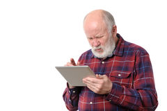 Senior man touching something at tablet computer screen, isolated on white Royalty Free Stock Image