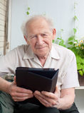 Senior man with a touchpad PC Stock Images