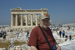 Senior man and tourists in Parthenon stock photo